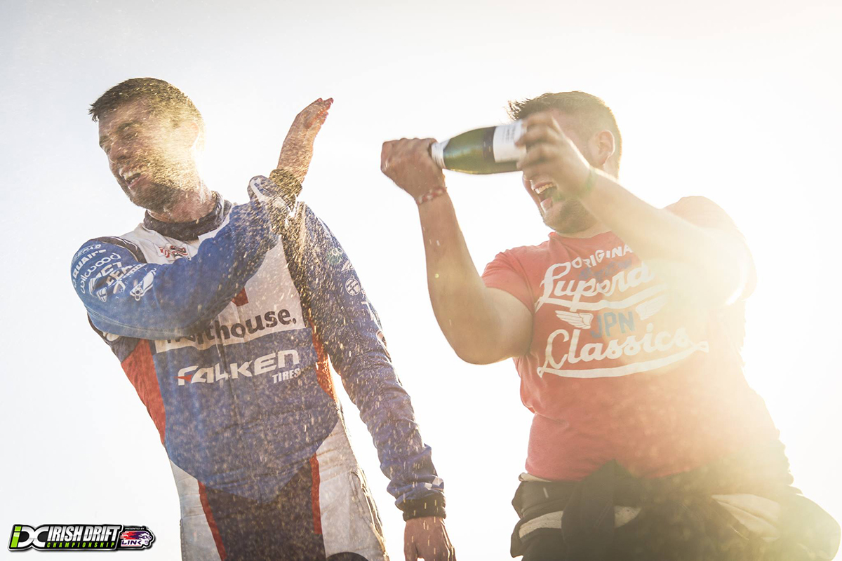 Jack Shanahan celebrating a win with champagne - Irish Drift Championships