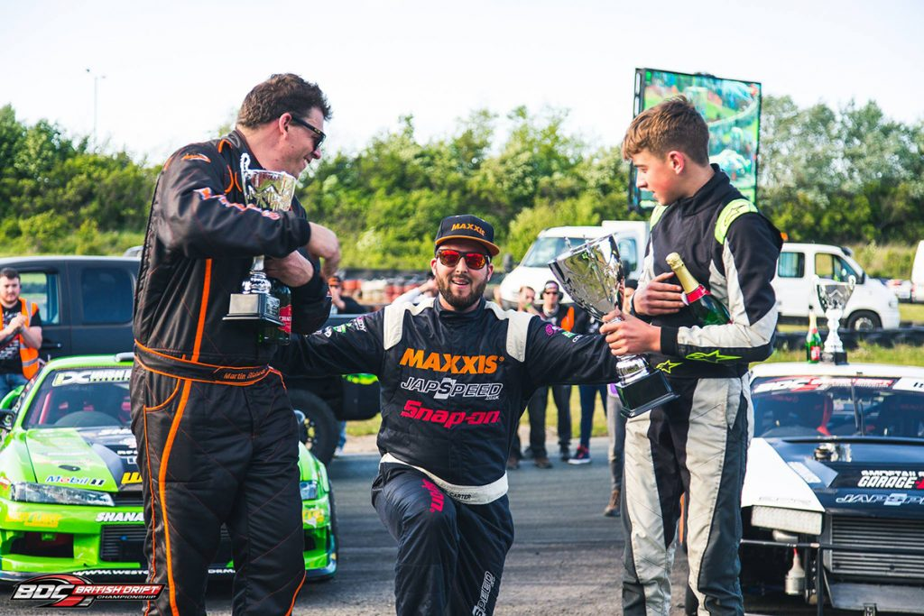 Matt Carter Celebrating at the BDC with trophy and champagne