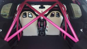 Back view of two Corbeau Sprint X custom bucket seats in pink and black
