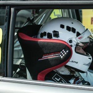 Racing Driver in Race Car with Corbeau Custom Bucket Seat