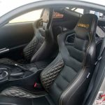 Black and Orange Custom Corbeau Bucket Seats in Race Car