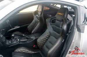 Black and Orange Custom Corbeau Bucket Seats in Race Car